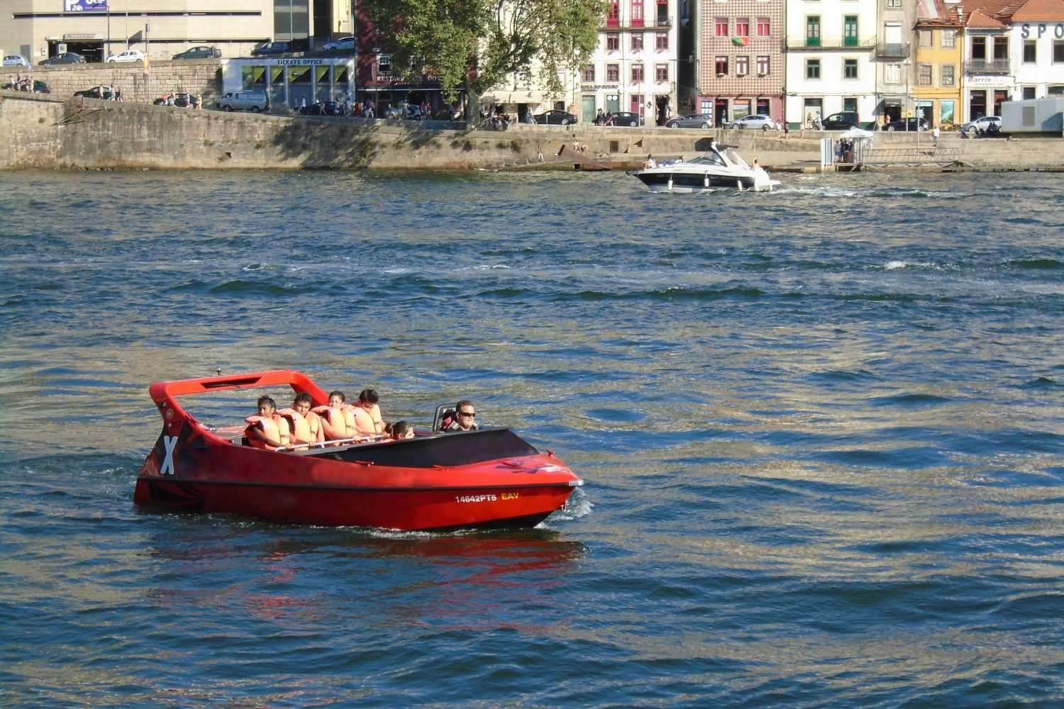 Jet boat at Douro river with view to Gaia