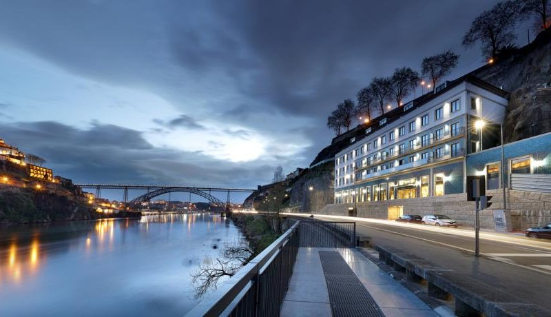Outside building of the Eurostars Porto Douro Hotel sunset with view to Douro River and Ponte Luis I
