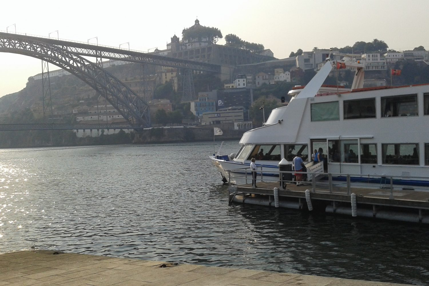 View over Luís I bridge and boat Porto Regua douro cruise
