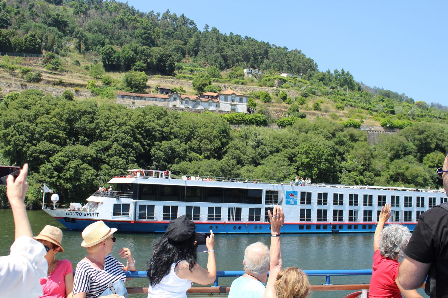 Saying hello to another boat in the Douro River