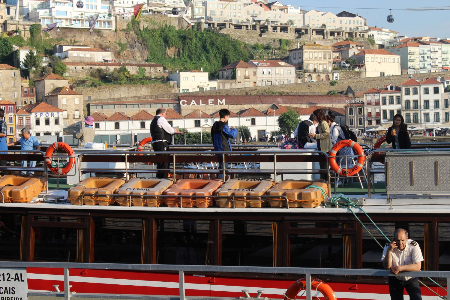 group on the deck of the boat taking a wellcome drink into Douro cruise with lunch or dinner on board