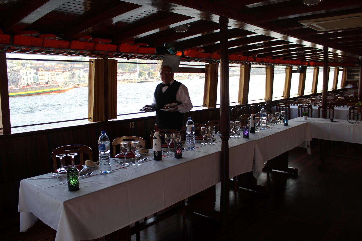 waiter serving appetizers in Douro cruise with lunch or dinner on board